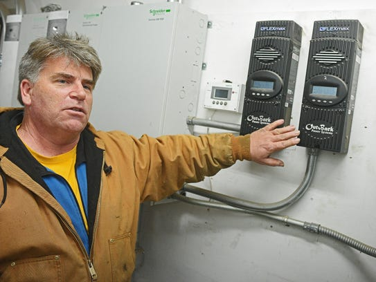 Paul Whitlock, with Sioux Falls Tower and Communications, shows a ...