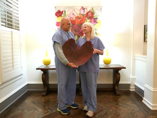 Cardiologists Carey Dellock and Niraj Pandit, still in their scrubs from a day's work at Capital Regional Medical Center, also share matters of the heart off the clock as a married couple, shown at their Tallahassee home on Tuesday, Feb. 13, 2018.