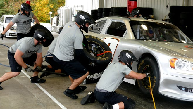 Lancaster resident Ryan Cheek (far left) was recently hired on a Hendricks Motorsports NASCAR pit crew as a jack man.