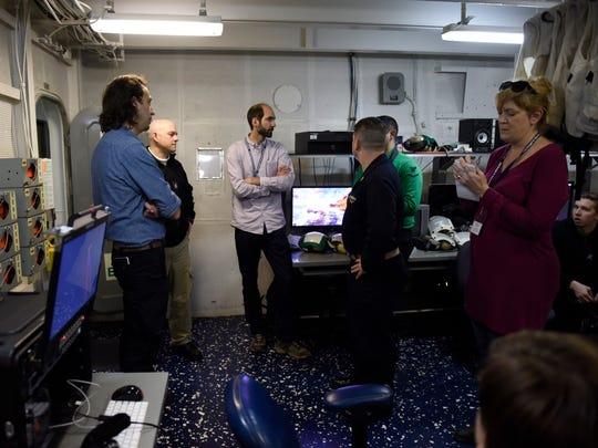 News Journal reporter Melissa Nelson Gabriel, far right,