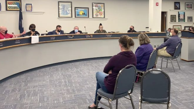 Aiken County Board of Education, left, discusses with members of its back-to-school advisory committee, right, what the best course of action is going forward for students in light of the high amount of recent COVID-19 activity during a general board meeting Tuesday, Nov. 17.