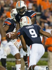 Auburn quarterback Jeremy Johnson (6) and running back Roc Thomas are expected to get more playing time against Samford.