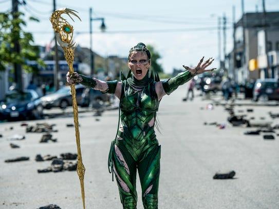Rita Repulsa (Elizabeth Banks) terrorizes the town
