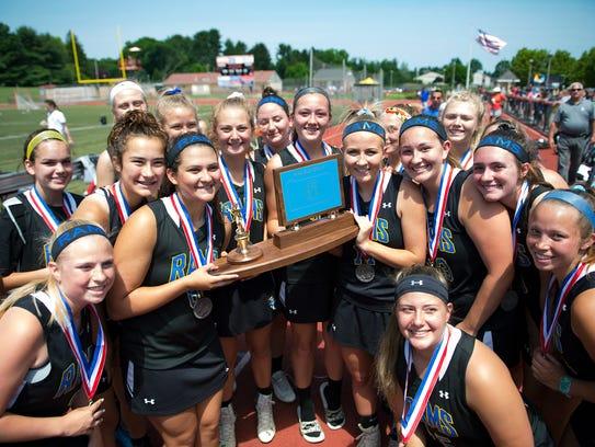 Members of the Kennard Dale Girls Lacrosse team accept