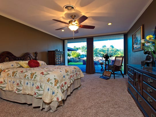The large master bedroom overlooks a patio and over-sized