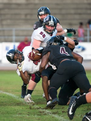 Josh Carter (4) tackles running back Tyrique Paramore (4) during the Chiles vs Navarre pre-season football jamboree game at Navarre High School on Thursday, August 17, 2017.