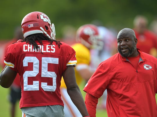 Kansas City Chiefs running backs coach Eric Bieniemy gives instruction to Jamaal Charles (25)  during a NFL training camp, Wednesday, July 30, 2014 on the Missouri Western State University campus in St. Joseph. Mo.  (AP Photo/St /Joseph News-Press, Todd Weddle)  ORG XMIT: MOSTN108