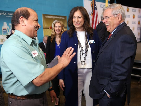 Victor Bonilla, an employee at Earth Friendly Products company ECOS for almost 30 years shares a laugh with CEO and President Kelly Vlahakis-Hanks and Sen. Bob Menendez as the company celebrated its 50th year anniversary.  April 13, 2017, Parsippany, NJ