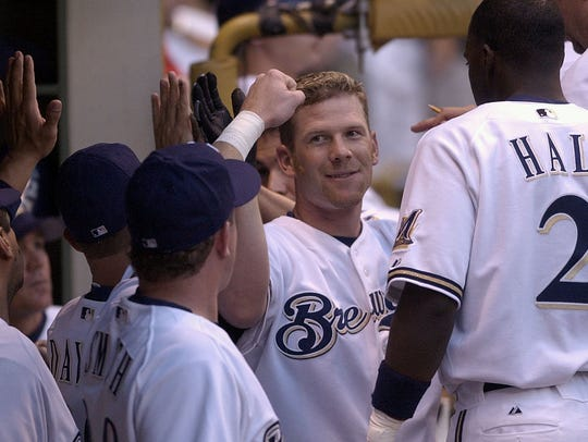 Milwaukee Brewers outfielder Geoff Jenkins is greeted