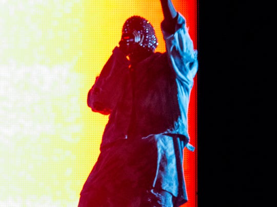 Kanye West performs on stage during the Made In America Festival at Grand Park on Sunday, Aug. 31, 2014, in Los Angeles.