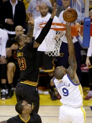 LeBron James blocks a shot by Andre Iguodala late in Game 7 of the 2016 NBA Finals.