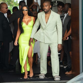 Kim Kardashian and Kanye West light up 2 Chainz's wedding with neon outfits