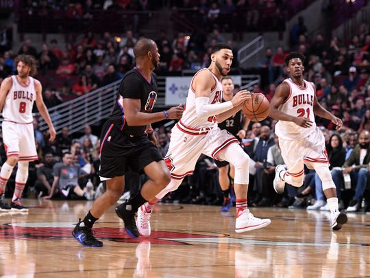 Denzel Valentine dribbles the ball against LA Clippers guard Chris Paul on March 4 at the United Center in Chicago. Valentine averaged 7.3 points in 23 minutes for the Chicago Bulls over the final 25 games of the regular season.