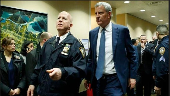 New York City Mayor Bill de Blasio, right, is escorted by New York City Police Department Chief of Department James P. O'Neill, into the emergency wing at Lincoln Hospital Thursday, Feb. 4, 2016, after NYPD Officer Patrick Espeut of Southeast and another officer were shot in a public housing project in the Bronx during an altercation with several suspects, one of whom apparently turned the weapon on himself.