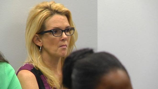 Denise Winchester listens as a county judge considers bond for her estranged husband who she says abducted her at gunpoint Friday.