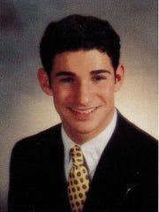 Craig Spencer is shown in his 1999 senior photo from