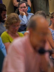 Don Sinex, rear, developer of the proposed Burlington Town Center redevelopment project , listens to public testimony during a meeting of the Burlington Planning Commission in Burlington on Wednesday, July 6, 2016.