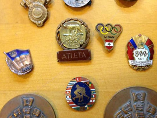 Some of the medals won by Nazem Amine as a Greco Roman wrestler.