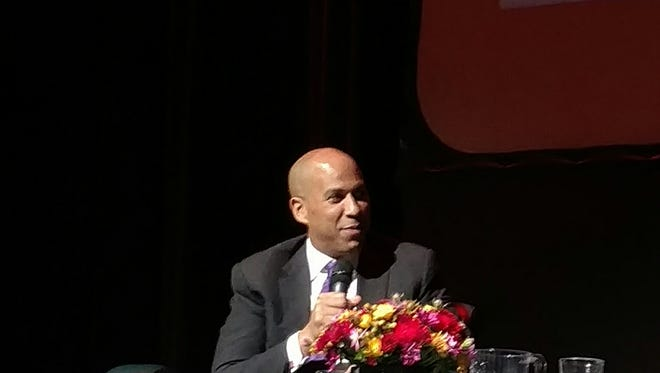 Sen. Cory Booker discussing the recent election with Wade Henderson, president of the Leadership Conference on Civil and Human Rights, at the University of the District of Columbia on Wednesday.