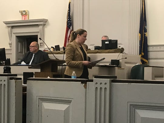 Assistant District Attorney Eliza Filipowski gives