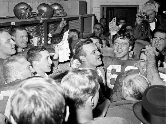 Norm Van Brocklin, left, who quarterbacked the Philadelphia Eagles to a 17-13 win over the Green Bay Packers Dec. 27, 1960 in NFL championship game in Philadelphia, Pa. alternately laughs and cries in dressing room at Franklin Field. With him is Chuck Bednarick. Van Brocklin said he planned to retire after the title game.