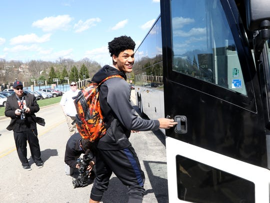 Xavier's Kaiser Gates boards a bus at Cintas Center Wednesday, March 16, 2016 before heading to the NCAA Tournament. Xavier, a number 2 seed, faces 15th-seeded Weber State in Friday's 9:20 p.m. first-round game at St. Louis' Scottrade Center.