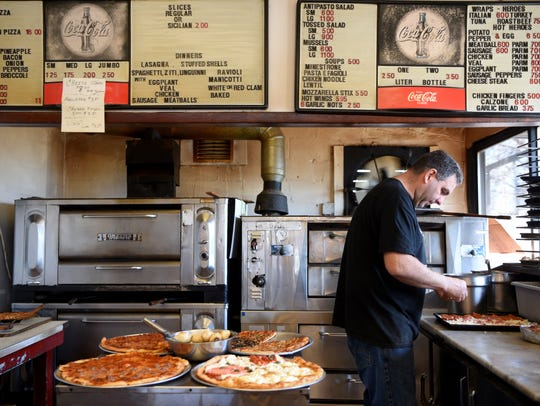 Frank Scaturro, co-owner of Lodi Pizza, makes a Sicilian