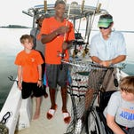 Clemson players team up with  youths for fishing trip