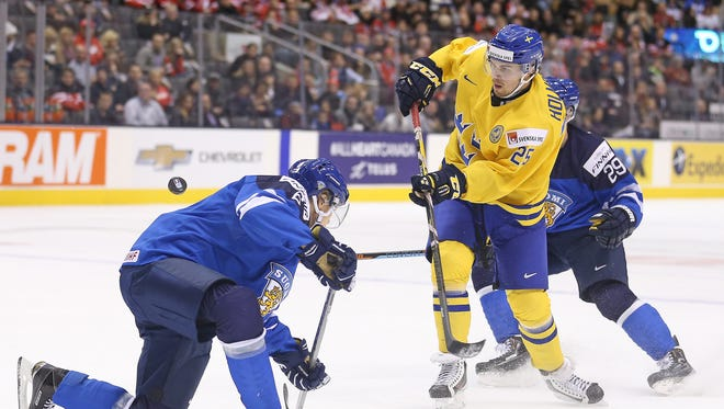 Axel Holmstrom of Sweden shoots against Finland during a quarterfinal game in the 2015 IIHF World Junior Hockey Championship at the Air Canada Centre on Jan. 2, 2015 in Toronto.