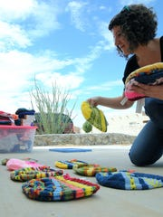 Tiffany Goolsby organizes donated hats that will later