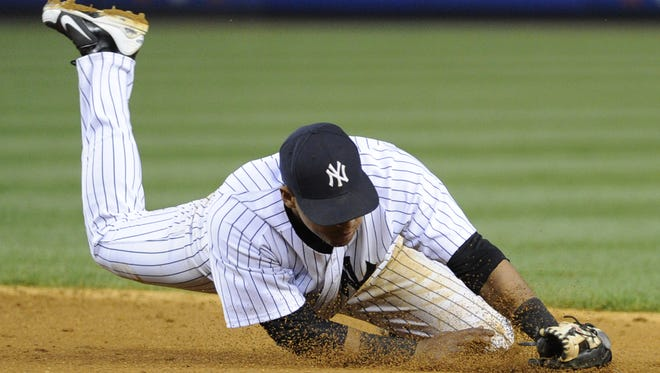 Yankees third baseman Yangervis Solarte makes a diving stop on a ball hit by the Angels' Hank Conger during the third inning  Friday night.