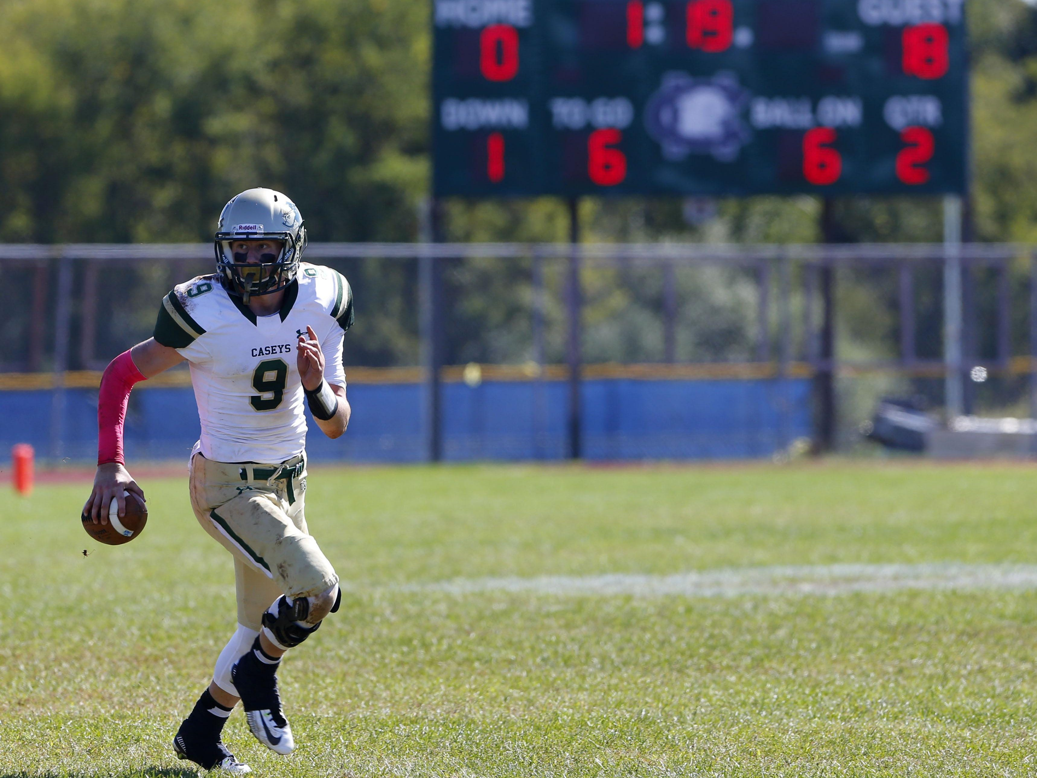 Eddie Hahn (9) of Red Bank Catholic looks for a receiver during game against Colts Neck at Colts Neck High School, Colts Neck,NJ. Saturday, October 10, 2015.