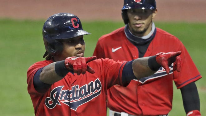 Cleveland Indians' Jose Ramirez celebrates after hitting a three-run home run in the third inning in a baseball game against the Minnesota Twins, Wednesday, Aug. 26, 2020, in Cleveland.