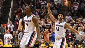 Mar 23, 2017; San Jose, CA, USA; Gonzaga Bulldogs guard Jordan Mathews (4) and guard Josh Perkins (13) celebrate against the West Virginia Mountaineers during the second half in the semifinals of the West Regional of the 2017 NCAA Tournament at SAP Center. Mandatory Credit: Kyle Terada-USA TODAY Sports