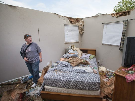 Lisa Skidmore surveys damage to her grandmother's house