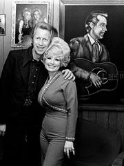 Porter Wagoner, left, and Dolly Parton announced at a small press conference Feb. 19, 1974 at Wagoner's Music Row office, that they would no longer be a team. Wagoner is looking for a replacement for his TV and road show, while Parton is looking for her own band.