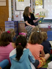 Kindergarten teacher Tiffany Dietzel reads a story