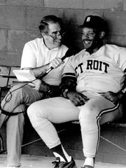 Paul Carey, a Tigers radio broadcaster for 19 seasons, chats with Cecil Fielder in 1991, Carey's last season. Carey joined the team in 1973.