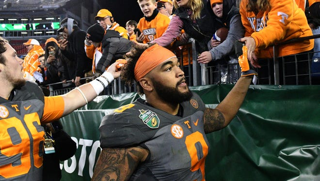 Tennessee defensive end Derek Barnett greets fans after the the Franklin American Mortgage Music City Bowl on Friday at Nissan Stadium in Nashville.
