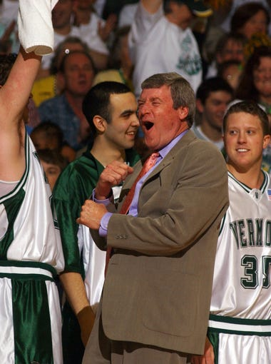 Coach Tom Brennan, center, and the University of Vermont men's basketball team celebrate on the bench during the 2005 America East championship game against Northeastern.