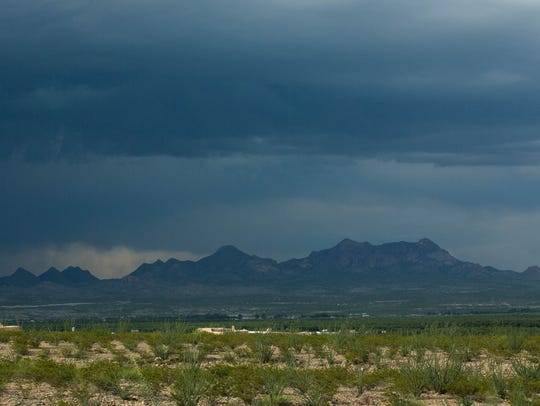 A large thunderstorm rolls over the Doña Ana Mountains