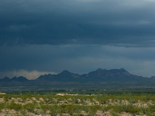 A large thunderstorm rolls over the Doña Ana Mountains Wednesday seen from the Prehistoric Trackways National Monument. Thursday Aug 24, 2017,  Interior Secretary Ryan Zinke filed his report to the president with his recommendations on what should happen to 27 national monuments, including the Organ Mountains-Desert Peaks, which includes the Doña Ana Mountains. The report was not made public.