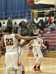 Smyrna's Tyra Hughes charges over Oakland's Correna