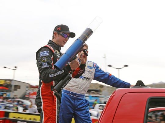 NASCAR Sprint Cup Series driver Kurt Busch holds a T-shirt launcher on Mar. 3, 2013 during driver introductions at Phoenix International Raceway.