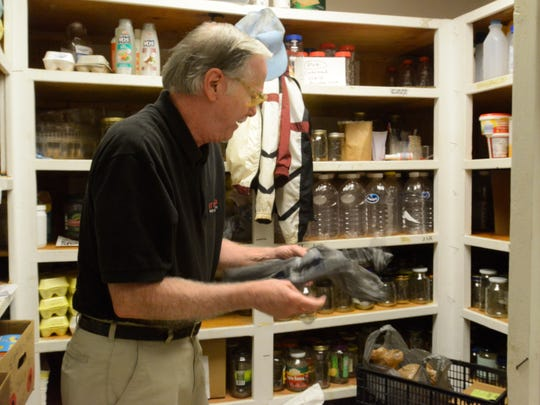 Michael Callahan sorts through plastic bags at ABCCM on Monday, September 21, 2015. He organizes and sorts storage containers among other various volunteer jobs at ABCCM. He volunteers twice a week.
