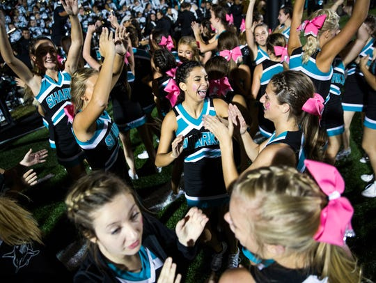 Gulf Coast High School cheerleaders celebrate their