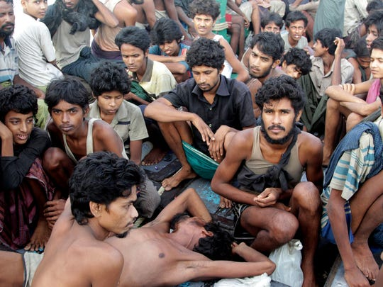 In this May 20, 2015, file photo, migrants including Myanmar's Rohingya Muslims sit on the deck of their boat as they wait to be rescued by Acehnese fishermen on the sea off East Aceh, Indonesia. Abdul Razak Ali Artan, the Somali-born student who carried out a car-and-knife attack at Ohio State University on Monday, reported railed on his Facebook account against U.S. interference in countries with Muslim communities. But he specifically protested the killing of Muslims in Myanmar _ also known as Burma _ where the Rohingya ethnic minority faces discrimination and occasional violence from the Buddhist majority and the army and bureaucracy. The Rohingya draw occasional international attention when the violence against them becomes too large to ignore, or when they seek foreign shores as boat people in great numbers, but their plight is generally ignored.