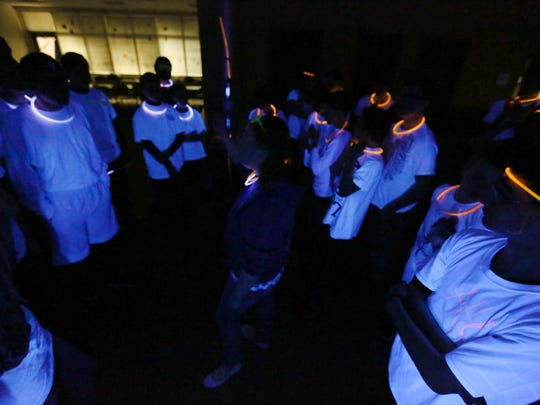 """Team Blue, left, and Team Larry are on the verge to start the Glow In The Dark Capture The Flag at the Manitowoc Public Library in March 2016. The Manitowoc Public Library, 707 Quay St., will host a special """"Glow in the Dark-Capture the Flag"""" event for teens from 6 to 8 p.m. Friday, Dec. 16."""