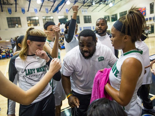 Chadrick Terrell, head coach for the Fort Myers High School girls basketball team, talks to his team during a timeout during game 6 of the Naples Holiday Shootout at Community School of Naples in East Naples on Wednesday, December 28, 2016. Fort Myers lost to Central Arkansas Christian High School.