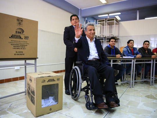 Ecuador's Lenin Moreno, second from right, waves after